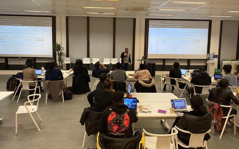 Monzo highlighting a group of black women coding class